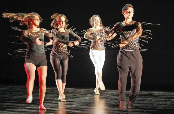 "Student dancers rehearse for Laguna Beach High's winter dance show ""Essence"" at the Artists Theatre on Wednesday."