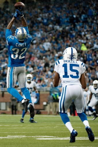 Lions defensive back Don Carey intercepts a pass intended for Colts wide receiver LaVon Brazill in the second quarter.