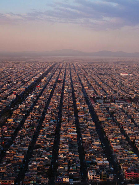 P.D. Smith's new book explores the history of and connection between cities ancient and modern, such as with Mexico City, whose sprawling borough Iztapalapa, above, was once an Aztec city.
