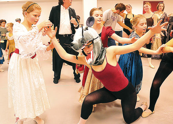 """Sisters Phoebe Rohrer, left, and Emily Rohrer, rehearse for the Western Maryland City Ballet Company's production of """"The Nutcracker."""" Phoebe portrays Clara, and Emily is a mouse doll."""