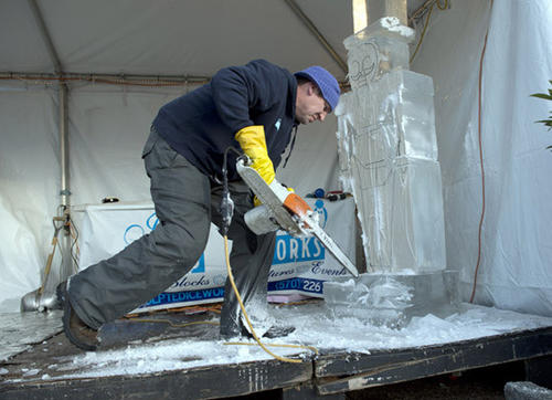 John Hanson, of Honesdale, working for Sculpted Ice Works carves a toy soldier in the Courtyard of Christkindlmarkt in Bethlehem on Thursday.