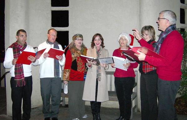 """Laguna carolers, led by Randy Hatfield (far right) welcomes attendees to the opening night of """"Plaid Tidings."""""""