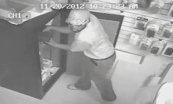 Broward Sheriffs detectives are searching for three men suspected of robbing an AT&T cell phone store at gunpoint