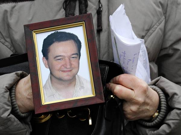 Nataliya Magnitskaya in 2009 holds a photograph of her son, Sergei Magnitsky, a lawyer who died in jail. William Browder, an investor and former client of Magnitsky's, has been telling leaders in the U.S. and other countries about Magnitsky's story and the human rights problems in Russia.