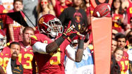USC receiver Marqise Lee, who has a nation-leading 112 catches, hauled in the highest honor for a college football receiver Wednesday when he was announced as the winner of the Biletnikoff Award.