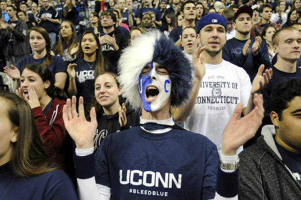 John Dearborn of Ansonia, a UConn senior, cheers wildly for his team during introductions Thursday night.