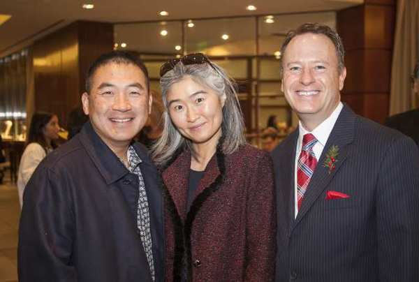 Simon and Teresa Lee with Tiffany & Co. store director Michael Botsko at a recent holiday breakfast.