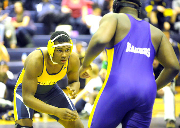 Catonsville's Jordan Reynolds, shown in last year's Baltimore County tournament wrestling against Loch Raven's Jordan Thompson, was one of eight Comets who earned pins in a 52-28 victory over Towson on Thursday. Thompson, who transferred from Loch Raven to Towson, had a pin for the Generals at heavyweight.
