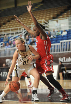 Lehigh #22 Elizabeth Sharlow is defended by Fairfield #32 Brittany Obi-Tabot in their women's basketball held at Stabler Arena on Thursday.