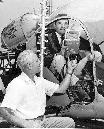 "KTLA engineer John D. Silva is pictured in 1958 with actor Gregory Peck sitting in the KTLA Telecopter, which was to be used to cover the opening of Peck's motion picture ""The Big Country."""