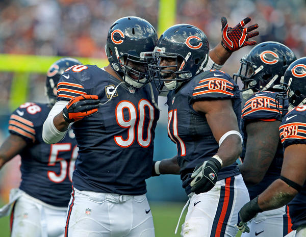 Defensive linemen Julius Peppers (No. 90) and Israel Idonije (No. 71) have been part of the Bears' sack machine this season.