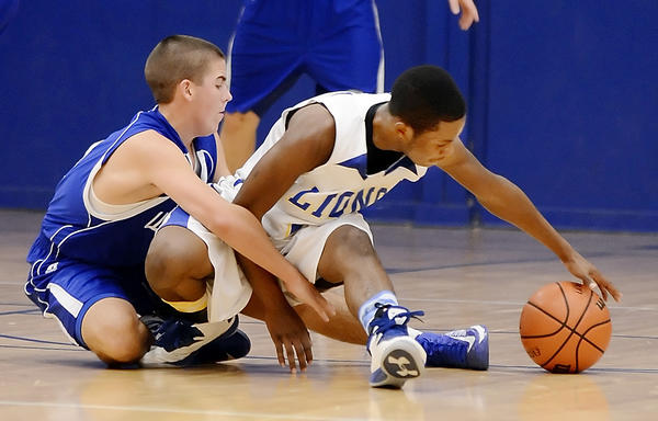 Williamsport's Ryan Crabtree, left, and Broadfording's Isaiah Daniels scramble for a loose ball in the second quarter of Thursday night's game at Broadfording.