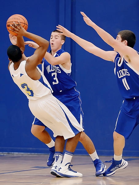 Broadfording's Moni Anderson, in white jersey, is double-teamed by Williamsport's Ryan Crabtree (3) and Riley Arnone (11) in the second quarter of Thursday night's game at Broadfording.