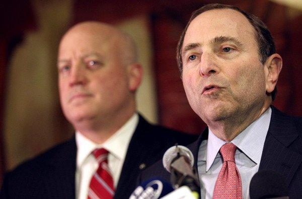 NHL Commissioner Gary Bettman, with Deputy Commissioner Bill Daly in the background, gives a grim report of the labor negotiating session Thursday.
