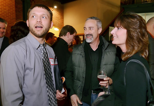 Hagerstown's new mayor, David S. Gysberts, left, talks with David and Norma Layton on Thursday evening during a meet-and-greet at Potomac Walk in downtown Hagerstown.