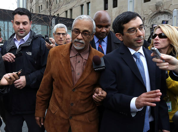 State Senator Donne Trotter, center, leaves court in Chicago.