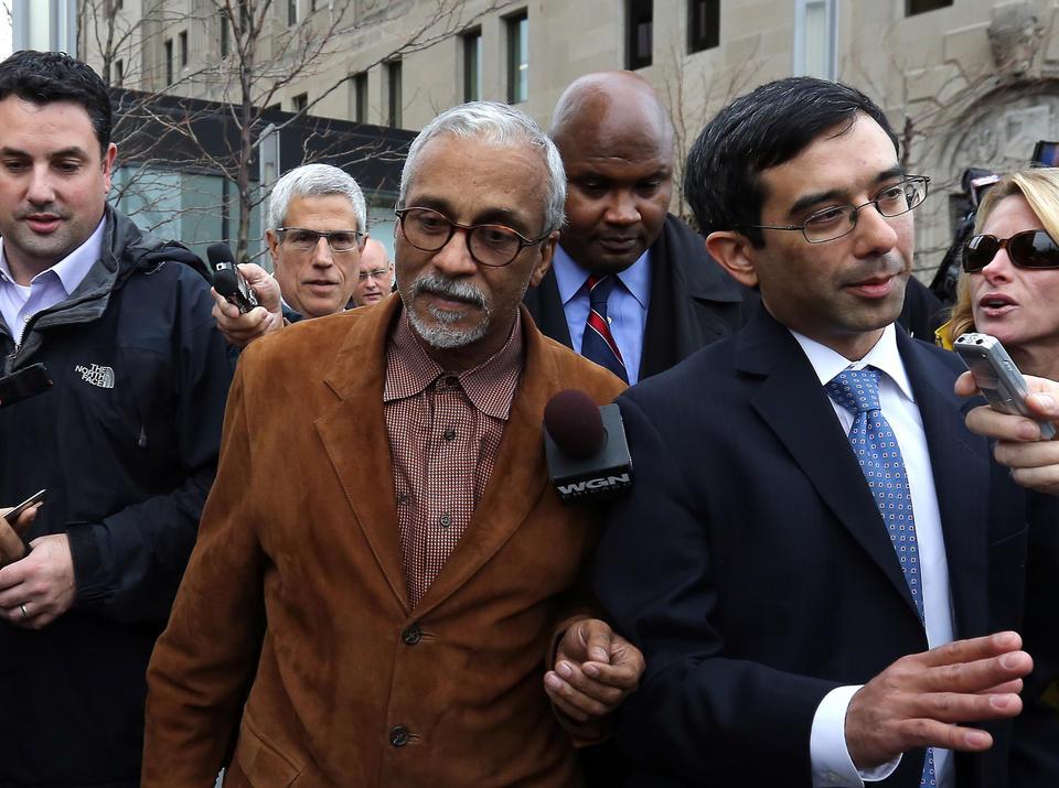 State Senator Donne Trotter, center, leaves court in Chicago.