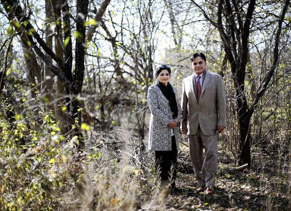 Zafar Sheikh and his wife, Aneeqa, have been trying to build a home on a wooded lot in Highland Park but have faced numerous roadblocks from neighbors and local officials.