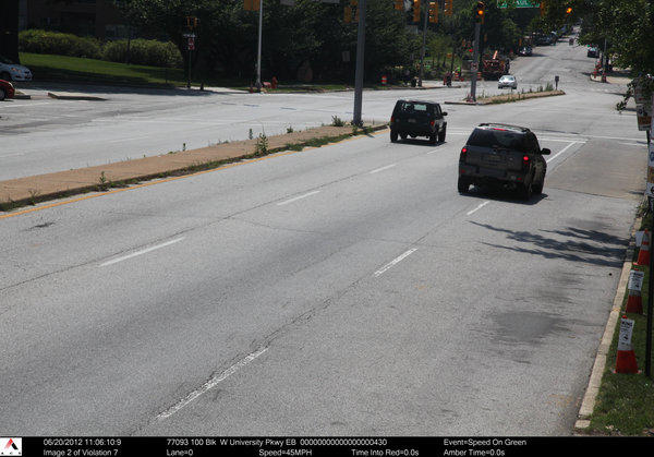 This time-stamped image is one of two taken 1.4 seconds apart on University Parkway that shows that the Chevrolet SUV on the right, whose driver was issued a speed camera ticket that said it was driving 45 mph, was actually driving just over 7 mph.