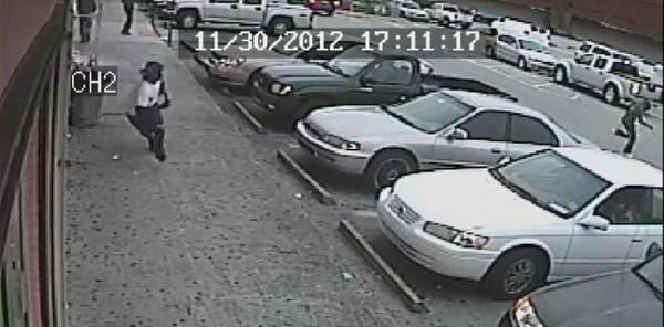 Masked gunman, seen in video, still being sought after two men shot and wounded at a Lauderhill barber shop