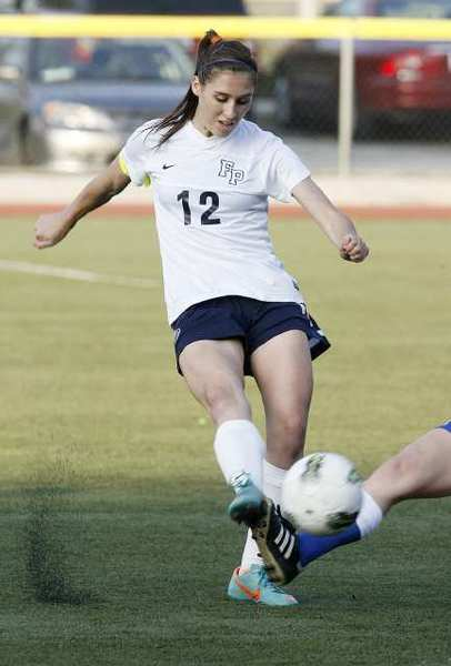 Flintridge Prep's Whitney Cohen passes the ball a split second ahead of the San Marino defender.