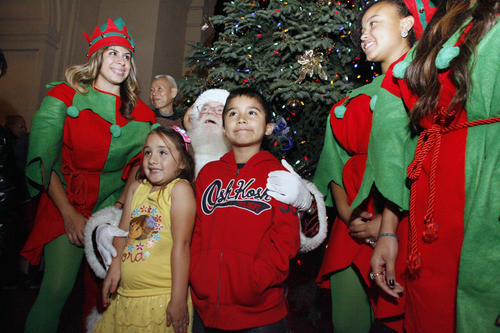 Linney Parra, 5 and Michael Cremona, 5, pose with Santa and his elves during a Christmas tree lighting which took place at Pasadena City Hall on Thursday, December 6, 2012.