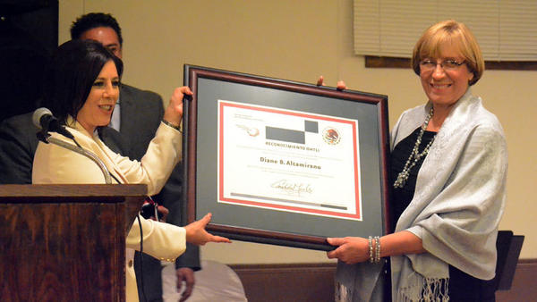 FROM LEFT: Mexican Consul Gina Andrea Blackledge Cruz presents Judge Diane B. Altamirano with the 2012 Ohtli Award on Thursday night in Calexico.