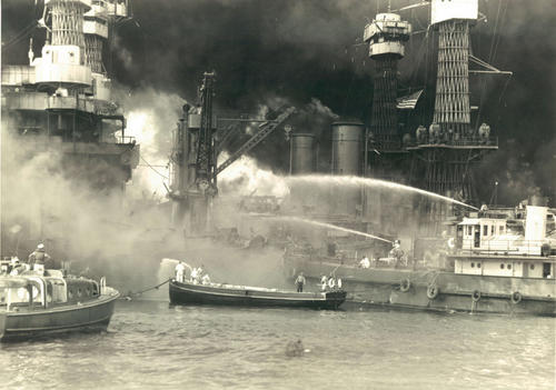 "United States battleships explode and burn, as the Japanese attack Pear Harbor, Hawaii, on Dec. 7, 1941 - ""a date which will live in infamy."""