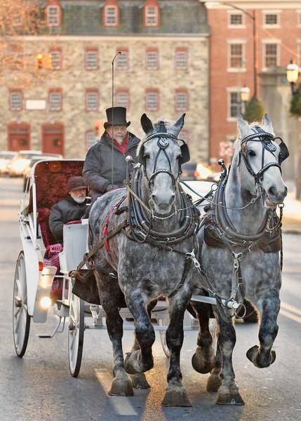Horse-drawn carriage rides are a popular part of downtown Bethlehem's busy holiday season.