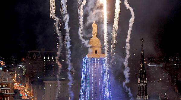 Fireworks illuminate the sky during the lighting of Baltimore's Washington Monument.