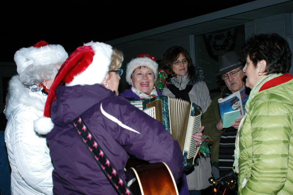Congregation members from various East Jordan churches brought an accordion, guitar and bells to accompany caroling downtown Thursday evening during the East Jordan holiday community night.
