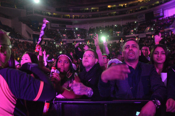The crowd at the XL Center cheers on Meek Mill, while he photographs them while hyping up his Instagram account. There was no shortage of Twitter and Instagram handle dropping through the course of the night.