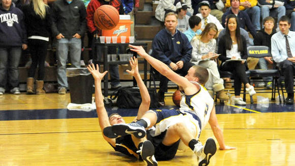 Gaylord's Tyler Cherry reaches for a loose ball during Gaylord's one-point loss to T.C. Central.