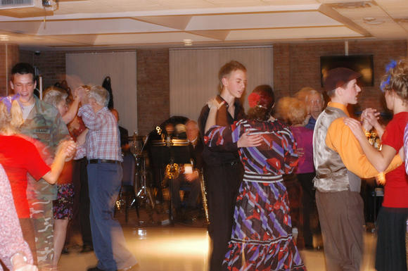 Couples enjoy swing dancing in October of this year at the North Central Michigan College cafeteria. The next swing dancing event takes place at 7:30 p.m. on Friday, Dec. 14, at North Central Michigan College in Petoskey.