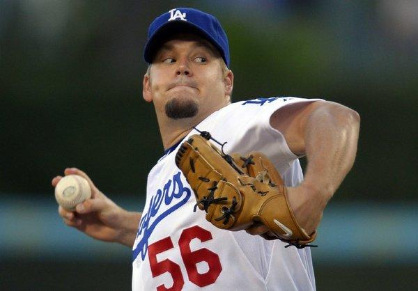 The Dodgers are talking with Fox Sports and Time Warner Cable. Pictured, pitcher Joe Blanton.