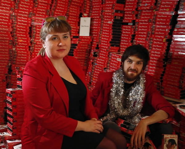 Aaron Maier (left to right), Katie Rife and Scott Whiteman with about 2,500 copies from their collection of Jerry Maguire VHS tapes.
