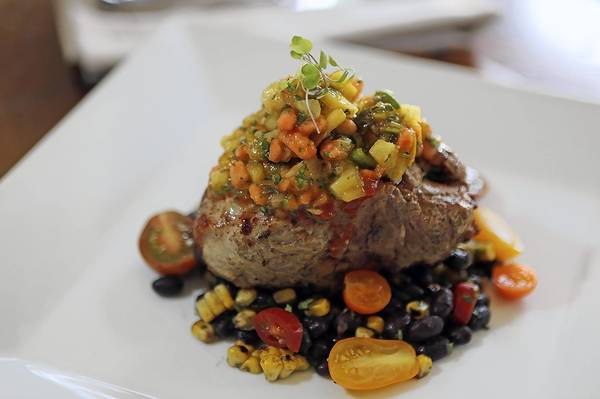 Grilled Berkshire Pork Chop at Fresh restaurant in Winter Park's Hannibal Square.