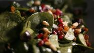 Recipe: Spinach salad with olives, pomegranate seeds and pine nuts