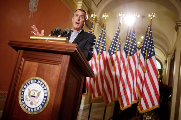 Speaker of the House John Boehner (R-Ohio) talks with reporters outside his office in the Capitol in Washington, D.C.