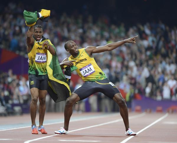 Yohan Blake (JAM) and Usain Bolt (JAM) celebrate after winning the gold in the men's 4x100m relay final during the London 2012 Olympic Games at Olympic Stadium.