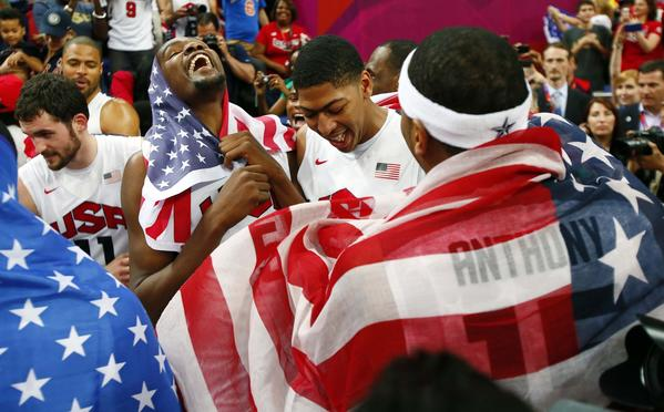 USA players Kevin Durant (left) , Anthony Davis (middle), and Carmelo Anthony (right) after defeating Spain 107-100 during the men's basketball gold medal game in the London 2012 Olympic Games at North Greenwich Arena.