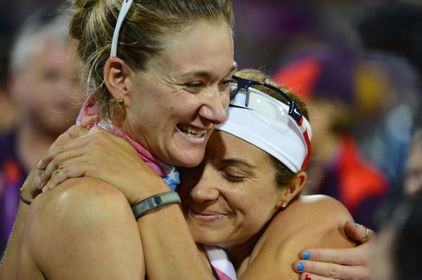 Misty May-Treanor and Kerri Walsh (left) embrace after winning the gold medal after defeating April Ross and Jennifer Kessy (USA) in the women's beach volleyball gold medal match during the 2012 London Olympic Games at Horse Guards Parade.