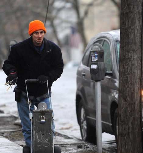 Bob White of Bethlehem Parking Authority tends to the parking meters in Bethlehem on Friday.