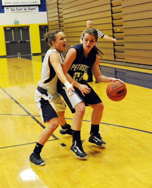 Petoskey junior Kati Lewis (right) looks to drive on Gaylord's Maddie Hamilla during Thursday's Big North Conference contest at the Gaylord High School gym. The Northmen defeated the Blue Devils, 43-25.