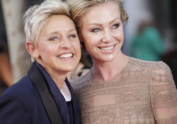 Ellen DeGeneres, left, stars in a Christmas commercial for J. C. Penney that has angered a Christian family group.