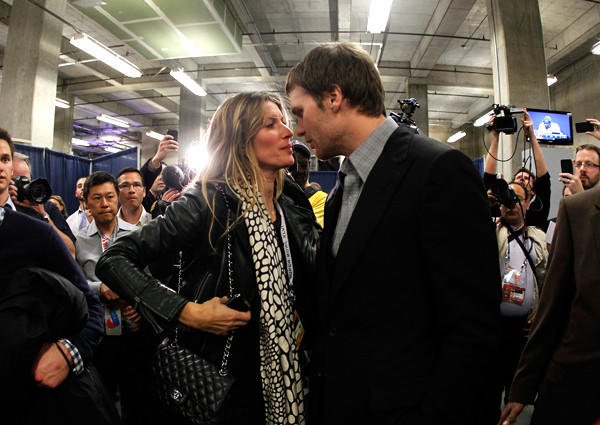 Gisele Bundchen and Tom Brady share a moment before his postgame news conference at the Super Bowl last winter.
