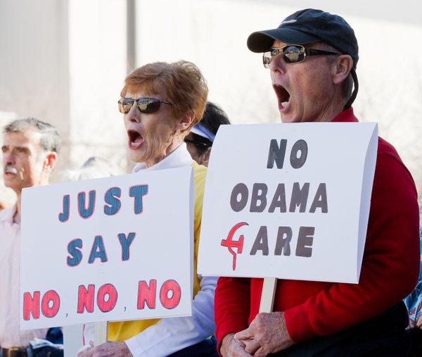 Retirees Barbara and Joe Napier participate in a tea party rally in Nashville.
