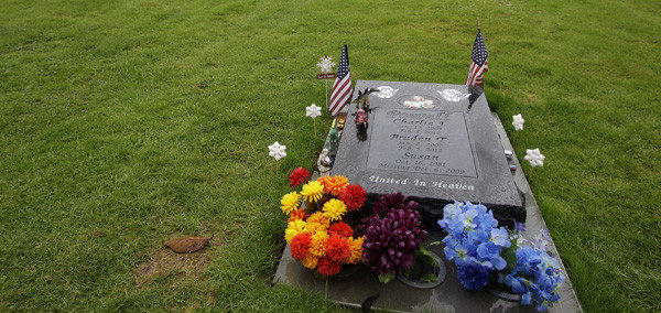 At Woodbine Cemetery in Puyallup, Wash., is the gravesite of Charlie and Braden Powell, who were killed by their father, Josh Powell, before taking his own life earlier this year.