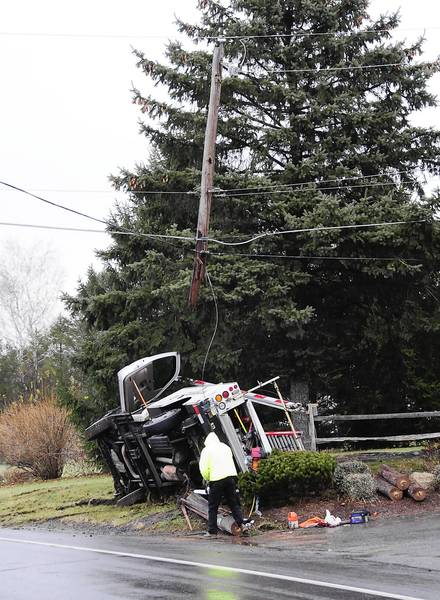 This utility truck of the Reading & Blue Mountain Railroad was traveling east on SR443 at the intersection with County Line road Friday morning when the driver lost control. The unit impacted with and snapped of a P.P. & L. utility pole carrying high power lines.