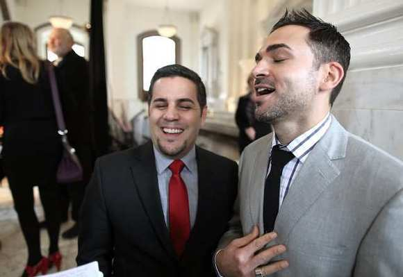 Paul Katami, right, and Jeff Zarillo, left, speak after a federal appeals court struck down California's ban on same-sex marriage last year.